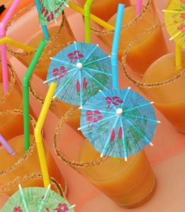 Orange drinks with umbrellas.
