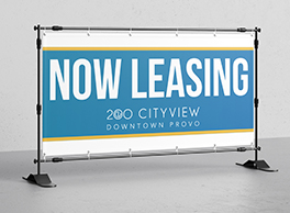 "An apartment sign that says ""Now Leasing""."