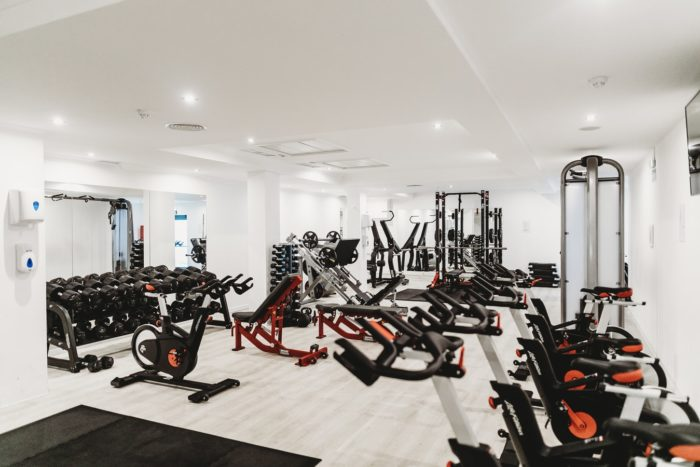 Benefit of living in a luxury apartment-A gym with better equipment.