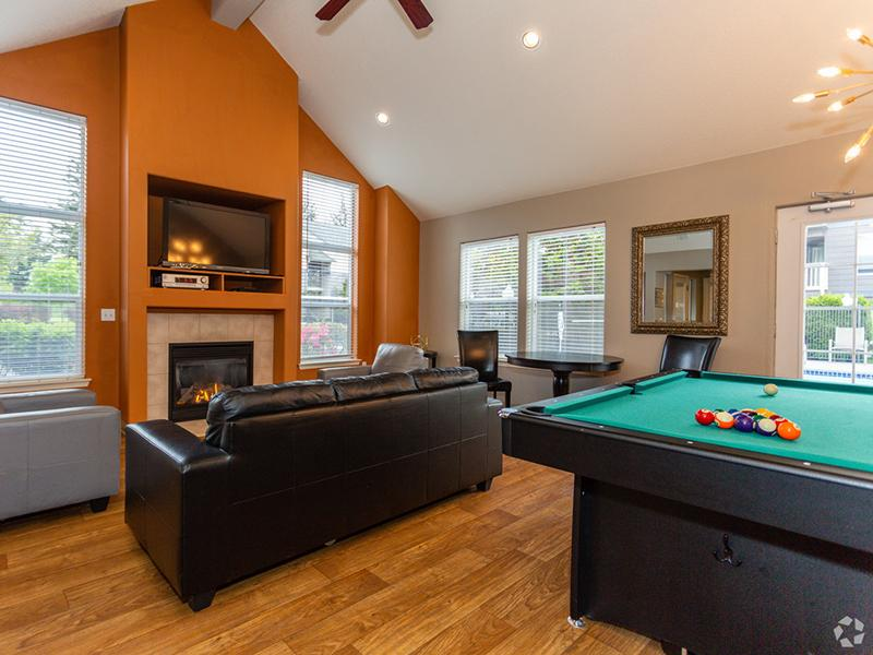 Apartments in Gresham, OR - Stark Street Crossings Club House with Billiards Table, TV, and a Fireplace