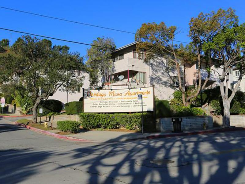 Apartments for Rent in Los Angeles, CA - Verdugo Mesa Apartments Welcome Sign Surrounded by Trees