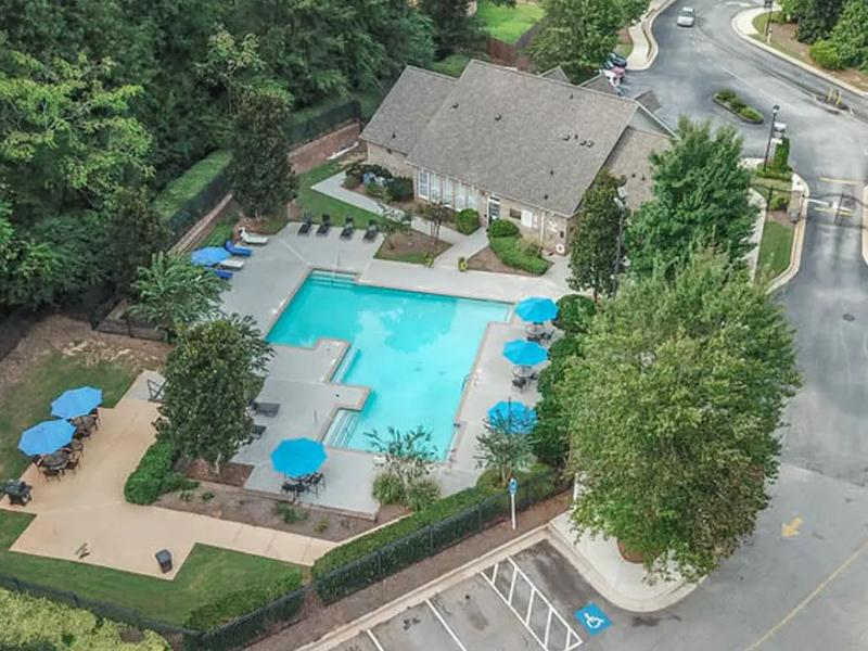 Aerial view of the clubhouse and pool at Retreat at Stonecrest Apartments in Lithonia, GA.