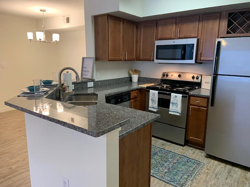 Model kitchen with a breakfast bar and stainless steel appliances in Brandon, FL.