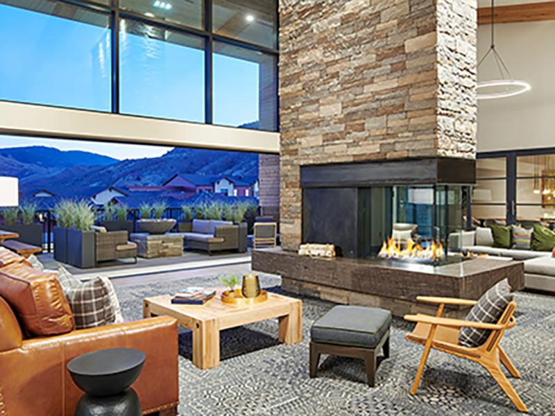 Interior Common Area With Fireplace | Epoque Golden Apartments in Golden, CO