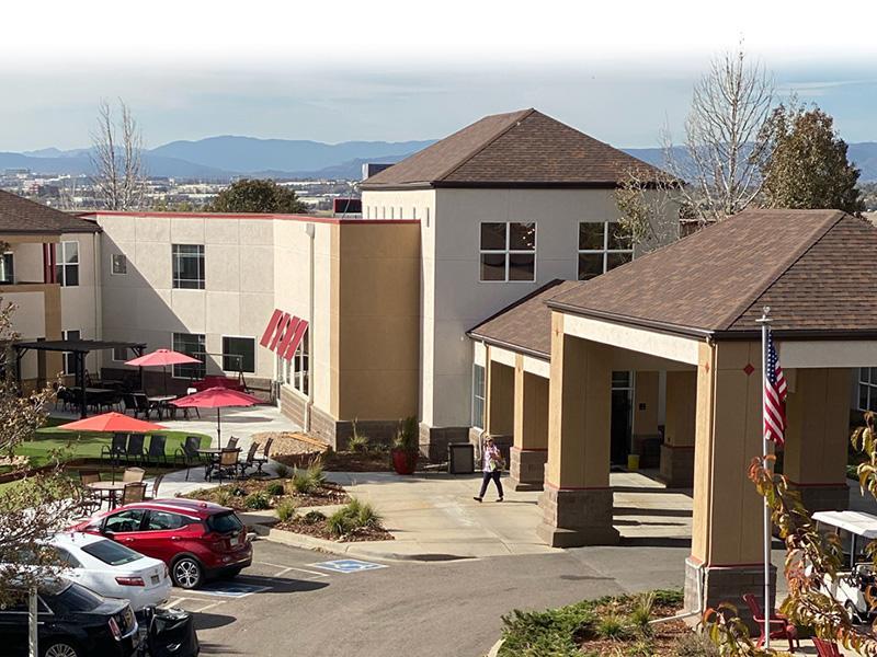 Clubhouse Exterior | V-Esprit Senior Apartments in Aurora Colorado