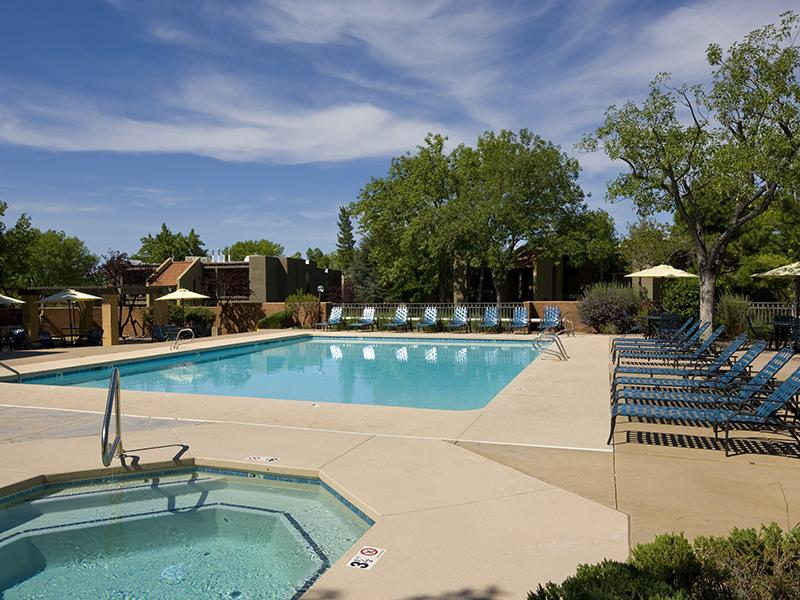 Swimming Pool with Lounge Chairs at Spain Gardens Apartments, Albuquerque, NM