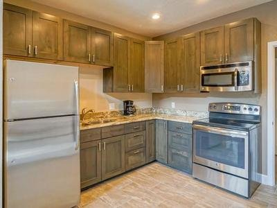 Club house kitchen | The Enclave Apartments